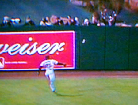 DCP02592.JPG: Bonds can't catch up to a ball hit by Glauss to deep left-center off a hanging breaking ball from Rob Nen, which scores two runs, bringing the Angels ahead 6-5.